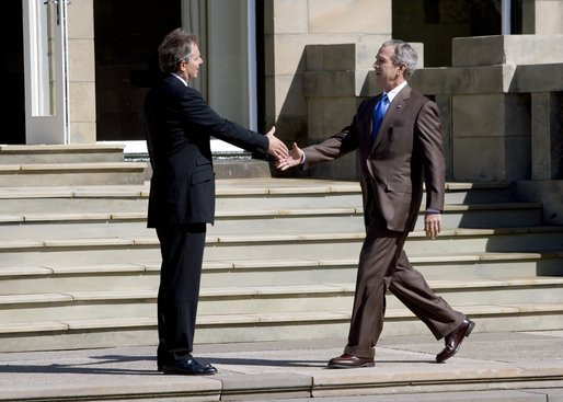 President George W. Bush is welcomed to Gleneagles Hotel in Auchterarder, Scotland, by the United Kingdom's Prime Minister Tony Blair Thursday, July 7, 2005, for the first G8 session. White House photo by Eric Draper