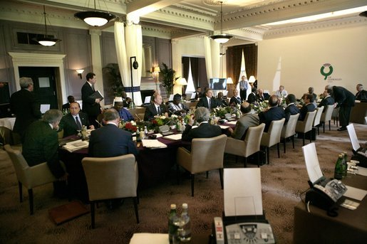 G8 leaders gather around the table for a morning session at the Gleneagles Hotel in Auchterarder, Scotland. The summit ended Friday, July 8, 2005. White House photo by Eric Draper