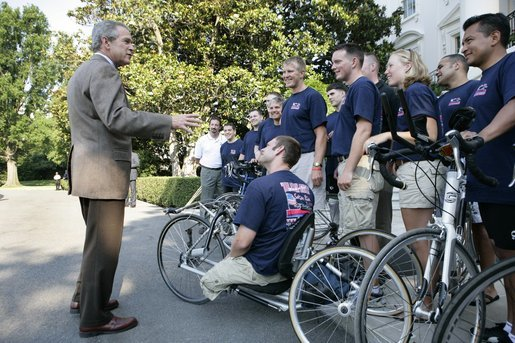 President George W. Bush speaks with members of Soldier Ride 2005 National Tour Team on the South Lawn of the White House, Sunday, July 10, 2005. Soldier Ride 2005, comprised of wounded service members, is a 4,200-mile, cross-country bike ride to raise money and support to help prepare wounded soldiers for long-term rehabilitation. White House photo by Eric Draper