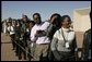 People wait in line to see the departure of Laura Bush Monday, July 11, 2005 at Gaborone International Airport in Gaborone, Botswana. White House photo by Krisanne Johnson
