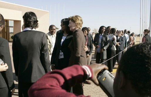 First Lady Laura Bush poses for pictures upon her departure Monday, July 11, 2005 at Gaborone International Airport in Gaborone, Botswana. White House photo by Krisanne Johnson