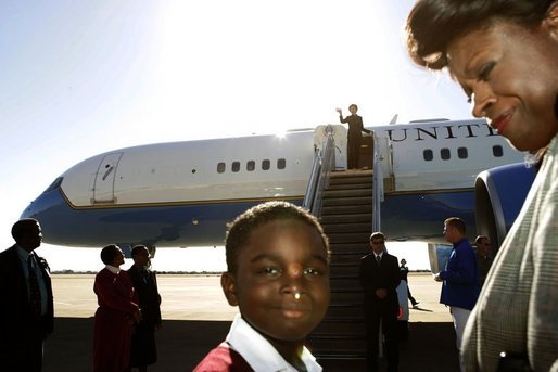 A child is seen on the tarmac at the departure of Laura Bush Monday, July 11, 2005 at Gaborone International Airport in Gaborone, Botswana. White House photo by Krisanne Johnson