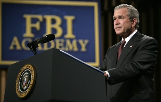 "President George W. Bush delivers remarks about key accomplishments and the ongoing efforts in the war on terrorism during a visit Monday, July 11, 2005, to the FBI Academy in Quantico, Va. Said the President, ""The FBI efforts are central to our success in the war on terror. And I thank you for that."" White House photo by Eric Draper"