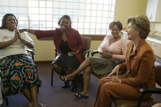 Laura Bush meets with women from Mothers to Mothers-to-Be in Cape Town, South Africa, Tuesday, July 12, 2005. The program provides support to HIV-positive women during their pregnancy. White House photo by Krisanne Johnson