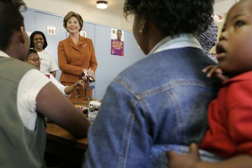 "Laura Bush visits with women involved with the program, ""Mothers to Mothers-to-Be,"" in Cape Town, South Africa, Tuesday, July 12. The program provides counseling, education and support to HIV/AIDS infected women during pregnancy. White House photo by Krisanne Johnson"
