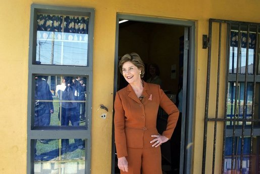 Laura Bush pauses in a doorway during an interview with Ann Curry of The Today Show at Philani, Tuesday July 12, 2005, in Cape Town, South Africa. White House photo by Krisanne Johnson