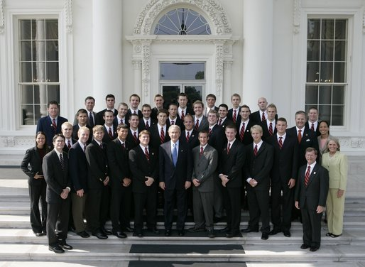 President George W. Bush stands with members of the Auburn University Men's Swimming and Diving team during Championship Day at the White House Tuesday, July 12, 2005. White House photo by Eric Draper
