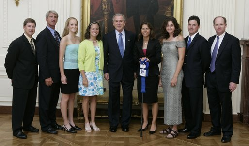 President George W. Bush stands with members of the Duke University Women's Golf team during Championship Day at the White House Tuesday, July 12, 2005. White House photo by David Bohrer