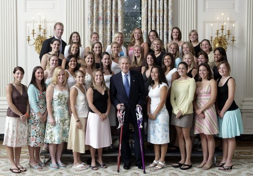 President George W. Bush stands with members of the Northwestern University Women's Lacrosse team during Championship Day Tuesday, July 12, 2005, at the White House. White House photo by David Bohrer