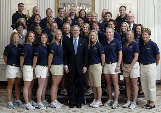 President George W. Bush stands with members of the University of Michigan Women's Softball team Tuesday, July 12, 2005, during Championship Day at the White House. White House photo by David Bohrer