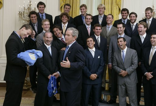 President Bush reacts with a joke as he is given a Speedo swim suit Tuesday, July 12, 2005 by members of the UCLA men's waterpolo team, who were attending ceremonies to honor NCAA 2004-2005 national championship teams. White House photo by David Bohrer
