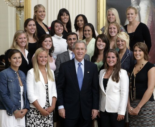 George W. Bush stands with members of the UCLA Women's Water Polo team Tuesday, July 12, 2005, during Championship Day at the White House. White House photo by David Bohrer