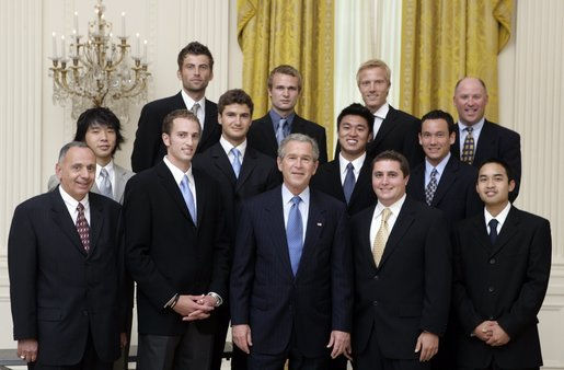 President George W. Bush stands with members of the UCLA Men's Tennis team during Championship Day Tuesday, July 12, 2005, at the White House. White House photo by David Bohrer