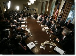 President Bush is joined by members of his cabinet as he speaks to news reporters, Wednesday, July 13, 2005, in the cabinet room at the White House.  White House photo by Eric Draper