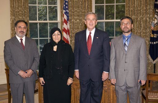President George W. Bush stands with the recipients of the 2005 Democracy Award of the National Endowment for Democracy Wednesday, July 13, 2005, in the Oval Office. The three democracy activists from Afghanistan are leaders of civil society organizations and have distinguished themselves in educating average citizens and local leaders about the basic values and principles of democracy. With the President, from left are: Mohammed Nasib, Sakeena Yacoobi and Sarwar Hussaini. White House photo by Eric Draper