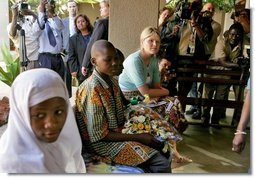 "Jenna Bush listens to children with HIV/AIDS at PASADA in Dar es Salaam, Tanzania, Wednesday, July 13, 2005. ""PASADA trains caregivers to provide home-based care for people living with AIDS. PASADA also provides support to orphans and other vulnerable children - boys and girls who have lost one or both of their parents to AIDS. These children need help with all the challenges that come with growing up - and with the responsibilities that an adult would usually handle,"" said Mrs. Bush in her comments.  White House photo by Krisanne Johnson"