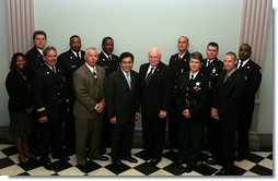 Vice President Dick Cheney and Attorney General Alberto Gonzales stands with recipients of the 2005 Public Safety Officer Medal of Valor Award in the Dwight D. Eisenhower Executive Office Building Thursday, July 14, 2005. The Medal of Valor is awarded to public safety officers cited by the Attorney General for extraordinary courage above and beyond the call of duty. White House photo by David Bohrer