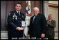 Vice President Dick Cheney awards Washington, D.C., Amtrack Police Officer Rodney Lee Chambers the Public Safety Officer Medal of Valor Award Thursday, July 14, 2005, during a ceremony in the Dwight D. Eisenhower Executive Office Building. The Medal of Valor is awarded to public safety officers cited by the Attorney General for extraordinary courage above and beyond the call of duty. Officer Chambers was on patrol June 9, 2003, at Union Station when reports came in regarding a man seen with a grenade. After Officer Chambers located and stopped the subject , the man pulled the pin. Officer Chambers grabbed the grenade and squeezed it, not allowing it to detonate. Officer Chambers waited roughly 20 minutes for the bomb disposal officers to arrive and dispose of the device. The device was later determined to be inoperable, yet this was unknown to Chambers at the time of the incident. White House photo by David Bohrer