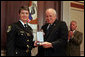 "Vice President Dick Cheney awards Deputy Jennifer Fulford, of Florida's Orange County Sheriff's Office, the Public Safety Officer Medal of Valor Award Thursday, July 14, 2005, during a ceremony in the Dwight D. Eisenhower Executive Office Building. Deputy Fulford responded to a burglary in progress call May 5, 2004, after an 8-year-old boy called 911 so say that ""strange men"" were in his home with weapons and that he and his sister were hiding inside a van in the garage. Deputy Fulford entered the garage to check on the children, and two men emerged from the house firing their weapons. Deputy Fulford, trapped in the garage, returned fire. She was struck a total of ten times, including in her shooting hand. She was still able to retrieve her weapon with her other hand and continue firing until both gunmen went to the ground. The children were kept safe and unharmed throughout the incident. White House photo by David Bohrer"