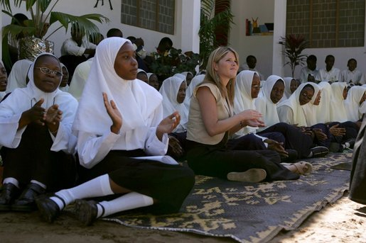 Jenna Bush sits with students at the Kiembesamaki Teacher Training School in Zanzibar, Tanzania, Wednesday, July 14, 2005. White House photo by Krisanne Johnson