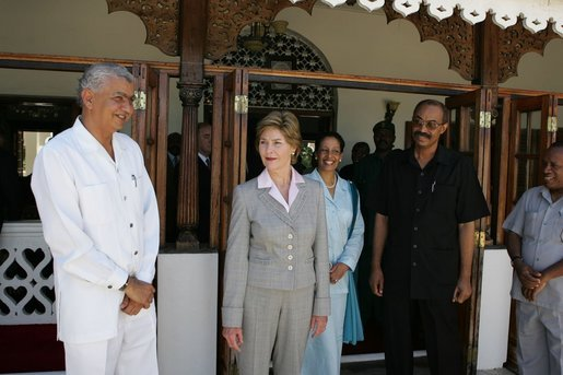 Laura Bush visits with President Amani Abeid Karume, pictured in black, at right, in Zanzibar, Tanzania, Thursday, July 14, 2005. White House photo by Krisanne Johnson