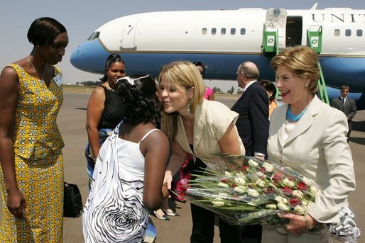 Laura Bush and daughter Jenna Bush are greeted at an arrival ceremony Thursday, July 14, 2005 at Kigali International Airport in Kigali, Rwanda. White House photo by Krisanne Johnson