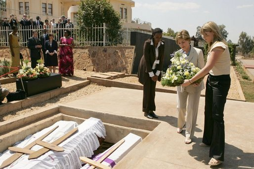 Laura Bush and daughter Jenna lay a wreath Thursday, July 14, 2005 at the Kigali Memorial Center-Gisozi Genocide Memorial in Kigali, Rwanda. White House photo by Krisanne Johnson