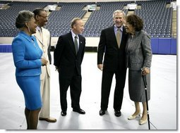 President George W. Bush is joined backstage by event participants before delivering remarks at the Indiana Black Expo Corporate Luncheon in Indianapolis, Ind., Thursday, July 14, 2005. Pictured with the President, from left are: Indiana Black Expo President Joyce Rogers, Chairman Arvis Dawson, Indiana Governor Mitch Daniels, and Congresswoman Julia Carson.  White House photo by Eric Draper