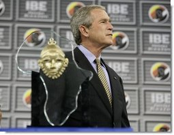 President George W. Bush stands on stage before receiving the Indiana Black Expo Lifetime Achievement Award at the Indiana Black Expo Corporate Luncheon in Indianapolis, Indiana, Thursday, July 14, 2005.  White House photo by Eric Draper