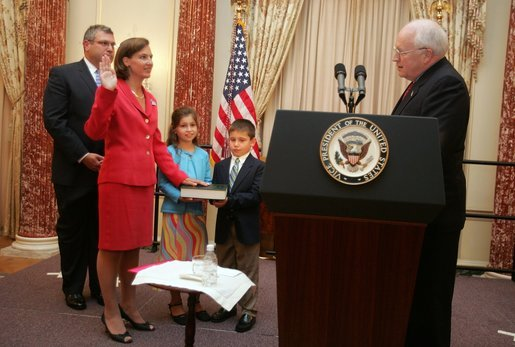 Vice President Dick Cheney swears in Toria Nuland as U.S. Ambassador to the North Atlantic Treaty Organization during a ceremony at the U.S. State Department Wednesday, July 13, 2005. Mrs. Nuland's family participated in the ceremony. White House photo by David Bohrer