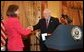 Vice President Dick Cheney congratulates Toria Nuland after her swearing-in as the Ambassador of the United States of America to the North Atlantic Treaty Organization Wednesday, July 13, 2005, at the U.S. State Department. Also pictured is Undersecretary of State Nicholas Burns. White House photo by David Bohrer
