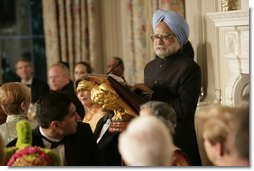 India's Prime Minister Dr. Manmohan Singh addresses guests during dinner in the State Dining Room, Monday evening, July 18, 2005, at the White House.  White House photo by Carolyn Drake