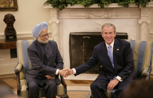 President Bush shakes hands with India's Prime Minister Dr. Manmohan Singh, Monday, July 18, 2005, during their meeting in the Oval Office. White House photo by Eric Draper