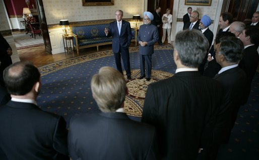 President George W. Bush stands with Prime Minister Manmohan Singh of India, in the Blue Room of the White House Monday, July 18, 2005, as they visit with U.S.-India CEO Forum members. White House photo by Eric Draper