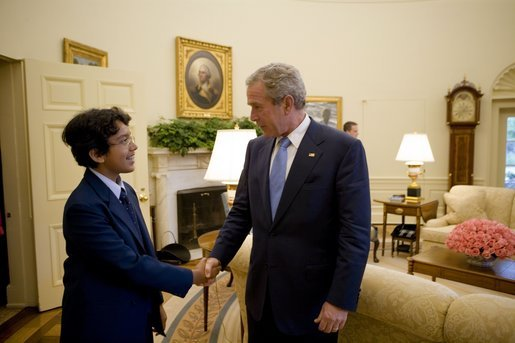 President George W. Bush welcomes 13-year-old Anurag Kashyap of Poway, Calif., the 2005 E. W. Scripps National Spelling Bee Champion, to the Oval Office Monday, July 18, 2005. White House photo by Eric Draper