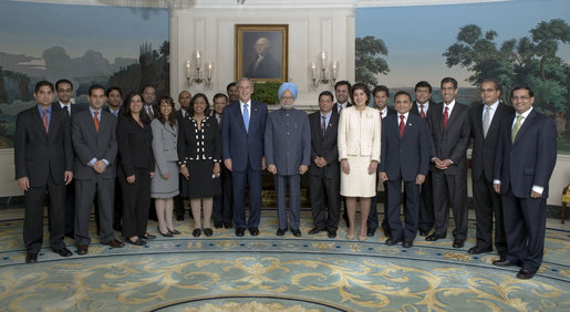 President George W. Bush and Prime Minister Dr. Manmohan Singh of India pose with Indian-American appointees working in the Bush administration in the Diplomatic Reception Room at the White House Monday, July 18, 2005. White House photo by Eric Draper