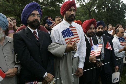 Invited guests are seen at the official arrival ceremony for India's Prime Minister Dr. Manmohan Singh, Monday, July 18, 2005, on the South Lawn of the White House. White House photo by Krisanne Johnson
