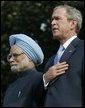 President Bush stands with India's Prime Minister Dr. Manmohan Singh, Monday, July 18, 2005 during the playing of the national anthems on the South Lawn of the White House. White House photo by Carolyn Drake