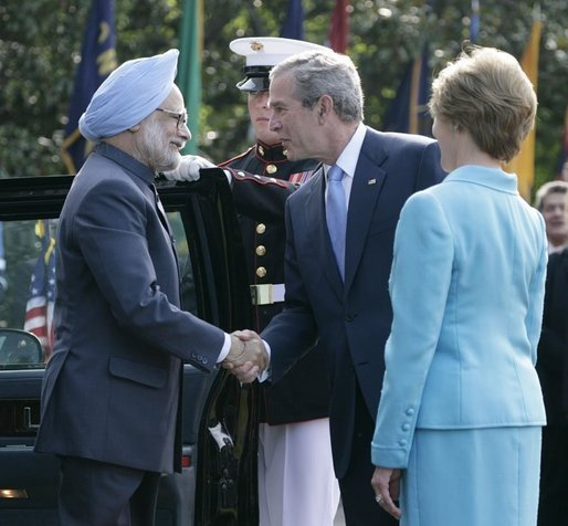 President George W. Bush and Laura Bush welcome India's Prime Minister Dr. Manmohan Singh upon his arrival to the White House, Monday, July 18, 2005. White House photo by Eric Draper