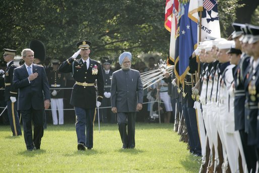 President George W. Bush reviews an honor guard with India's Prime Minister Dr. Manmohan Singh , Monday, July 18, 2005, on the South Lawn of the White House, during Singh's official arrival ceremony. White House photo by Eric Draper