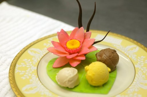 Three ice creams presented on a white chocolate lily pad with a lotus flower. White House Executive Pastry Chef Thaddeus DuBois created for the Official Visit of the Prime Minister of India July 18, 2005. White House photo by Shealah Craighead