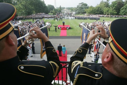 President George W. Bush and Laura Bush are seen waiting below, Monday, July 18, 2005 at the White House, as trumpeters signal the official arrival of India Prime Minister Dr. Manmohan Singh. White House photo by David Bohrer
