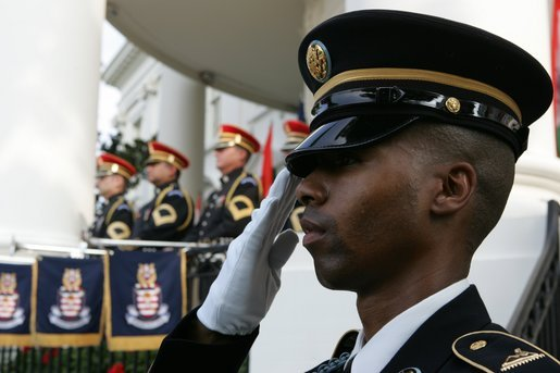 A member of the 3rd U.S. Infantry Old Guard Ceremonial Unit salutes Monday, July 18, 2005, at the arrival ceremony for India's Prime Minister Dr. Manmohan Singh, on the South Lawn of the White House. White House photo by David Bohrer
