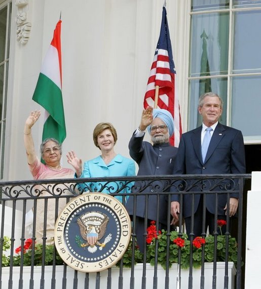 President Bush stands with India's Prime Minister Dr. Manmohan Singh, Laura Bush and Singh's wife, Mrs. Gursharan Kaur, Monday, July 18, 2005 during the Prime Minister's official visit to the White House. White House photo by David Bohrer
