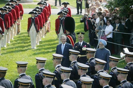 President George W. Bush reviews an honor guard with India's Prime Minister Dr. Manmohan Singh, Monday, July 18, 2005, on the South Lawn of the White House, during Singh's official arrival ceremony. White House photo by Lynden Steele