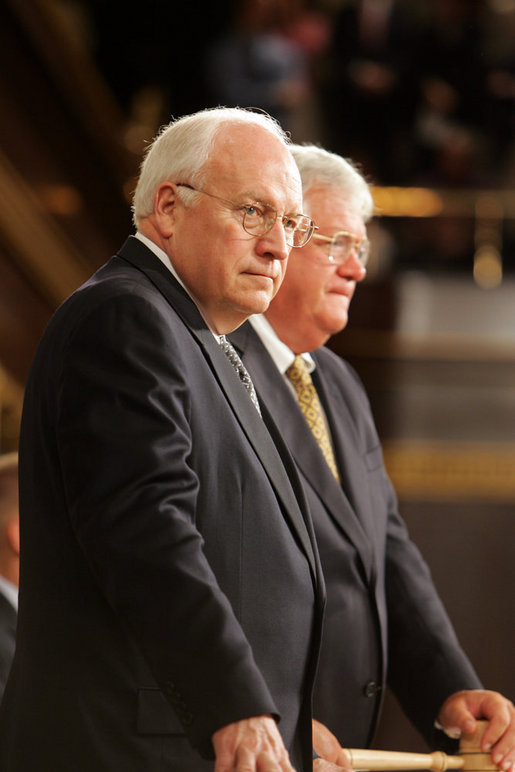 Vice President Dick Cheney and Speaker of the House Dennis Hastert stand to welcome Prime Minister Dr. Manmohan Singh of India before Dr. Singh addresses a Joint Meeting of Congress at the U.S. Capitol Tuesday, July 19, 2005. White House photo by David Bohrer
