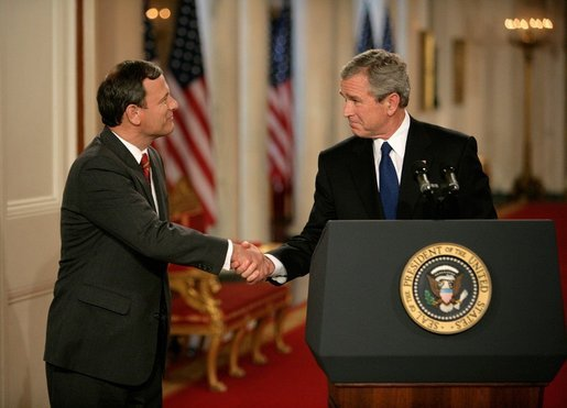 President George W. Bush shakes hands with his Supreme Court Justice Nominee John Roberts after his remarks on the State Floor of the White House, Tuesday evening, July 19, 2005. White House photo by Eric Draper