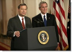 President George W. Bush looks on as his Supreme Court Justice Nominee John Roberts delivers remarks on the State Floor of the White House, Tuesday evening, July 19, 2005. White House photo by Eric Draper