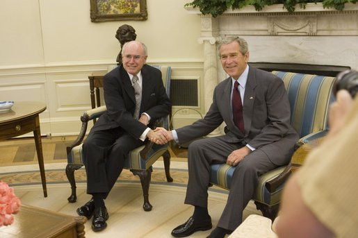 President George W. Bush shakes hands with Prime Minister John Howard of Australia, as he welcomes the Prime Minister to the Oval Office Tuesday, July 19, 2005, at the White House. White House photo by Carolyn Drake