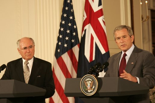 President George W. Bush gestures as he answers a reporter's question Tuesday, July 19, 2005, during a joint press availability with Australia's Prime Minister John Howard in the East Room of the White House. White House photo by Carolyn Drake